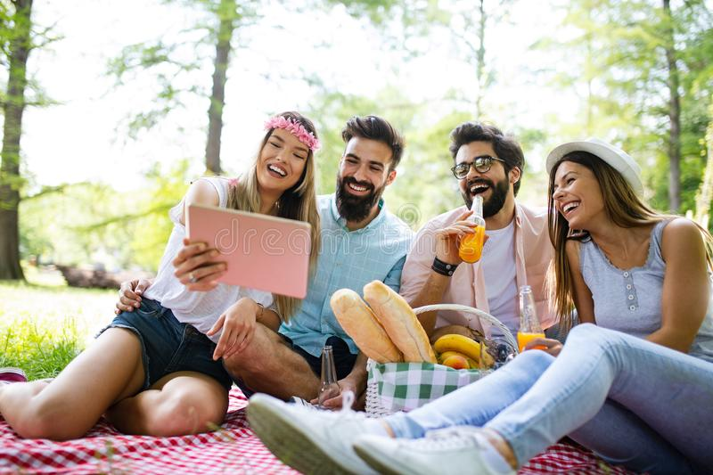Happy young friends having fun outside in nature, taking selfie royalty free stock photo