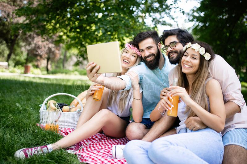Happy young friends having fun outside in nature, taking selfie royalty free stock photography