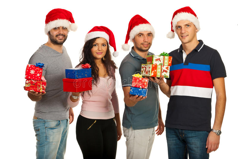 Happy friends holding Christmas gifts royalty free stock photo
