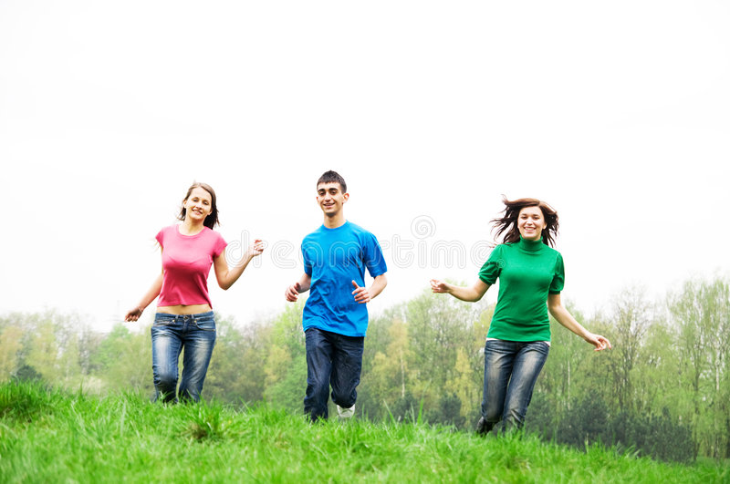 Happy friends jumping stock photography