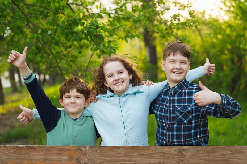 Happy friends  kids hands up  and show positive emotion stock photos