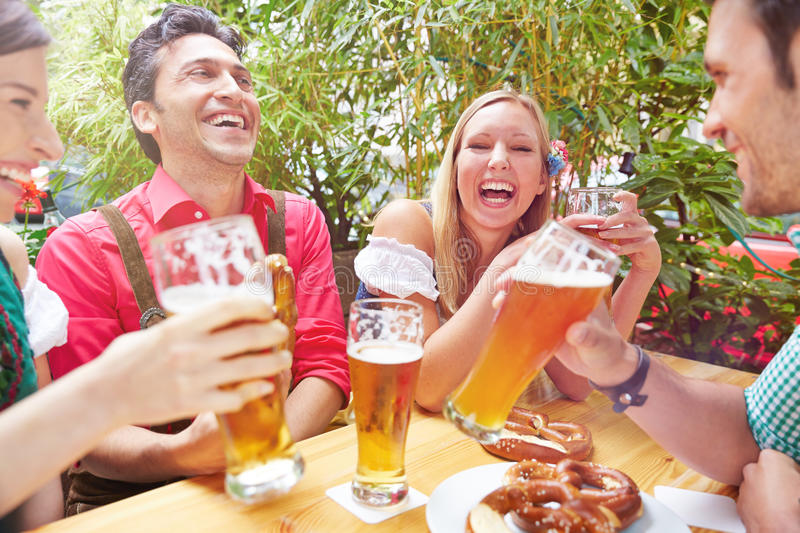 Happy friends laughing in beer royalty free stock images