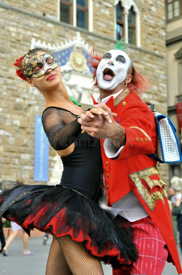 Happy friends for life: a clown and a ballerina. Street artist in Florence , Italy.Funny , happy clown male with a very Young and beautiful dancer on stairs in stock image