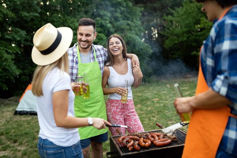 Friends making barbecue and having lunch in the nature stock photos