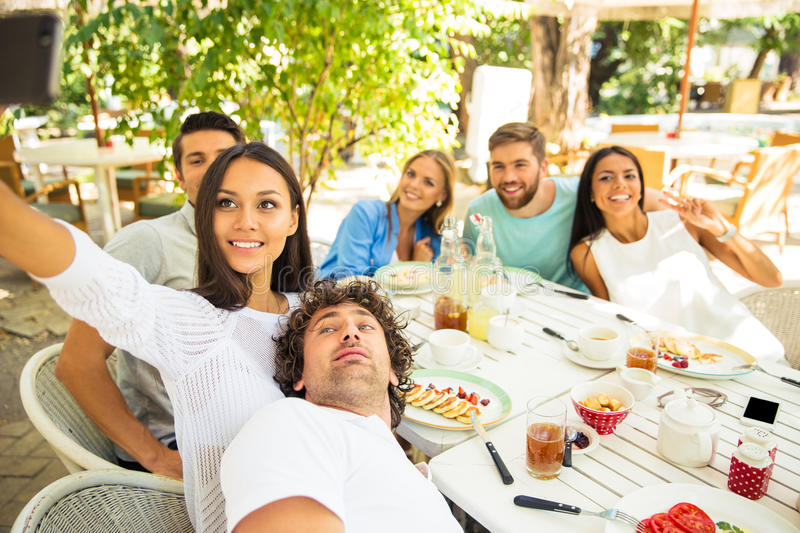 Happy friends making selfie photo royalty free stock image