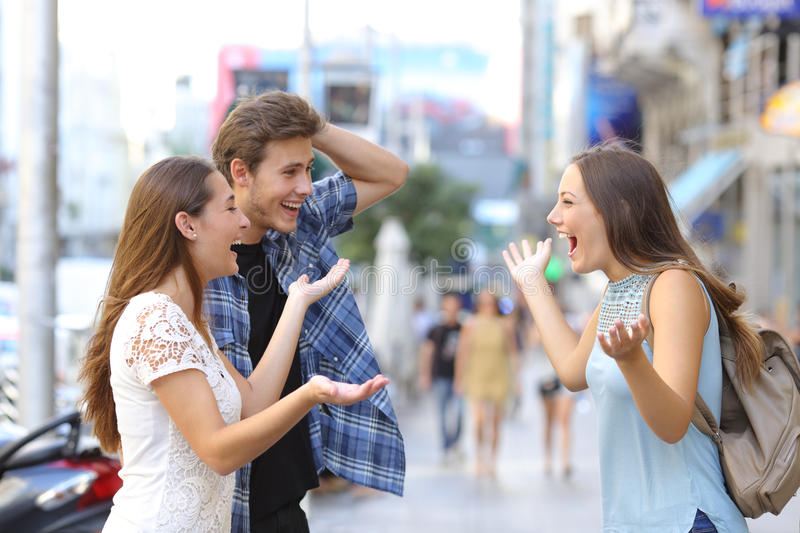 Happy friends meeting in the street stock image