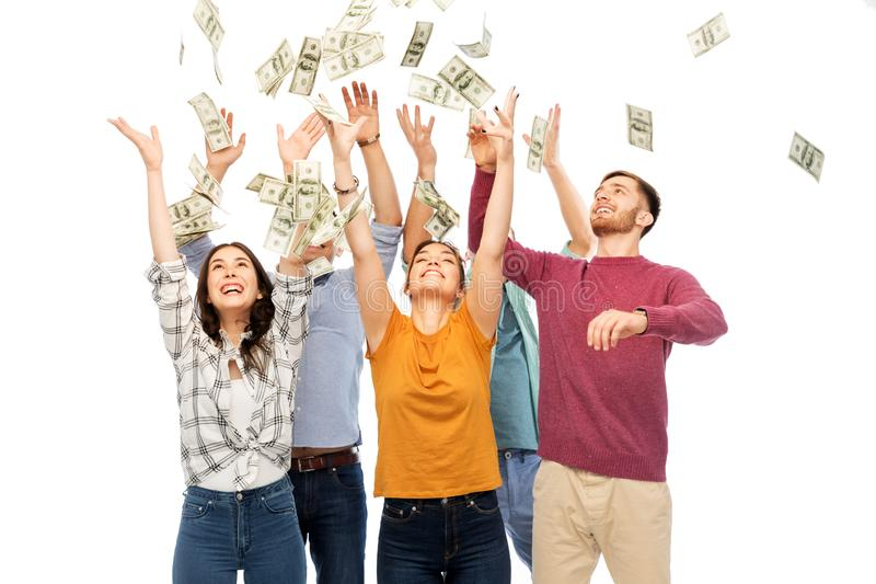 Happy friends picking money falling from up above stock photography