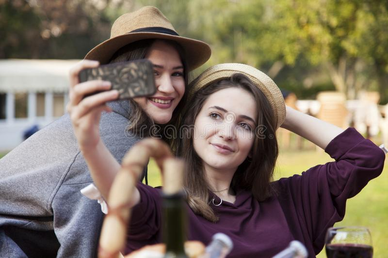 Happy friends on picnic in park royalty free stock images