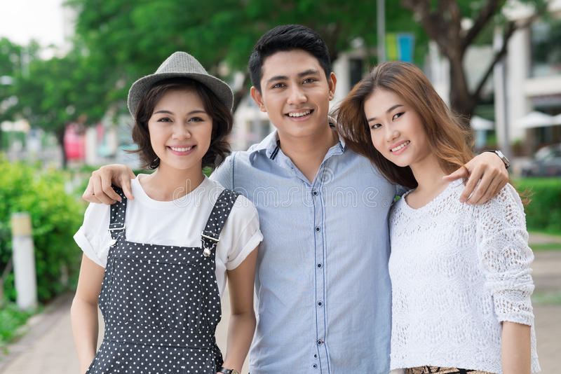 Happy friends. Portrait of young people standing together outside royalty free stock photos