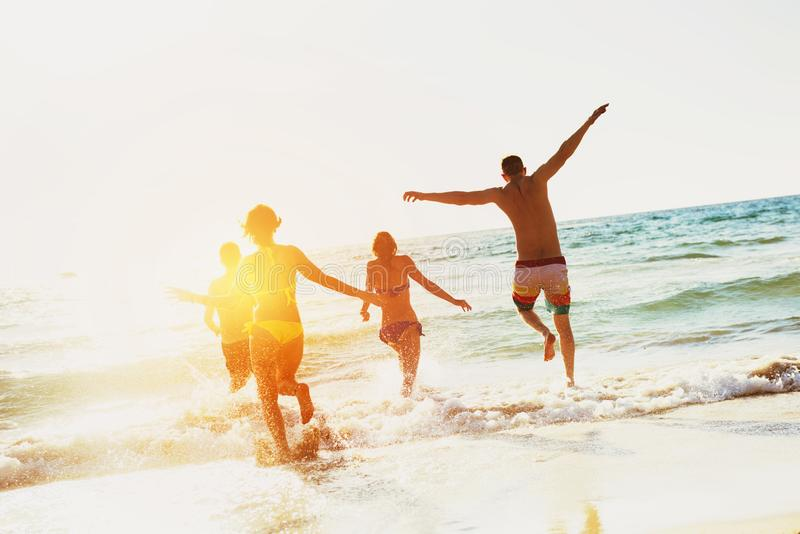 Happy friends sea beach holidays stock photography