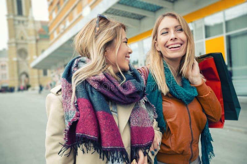 Happy friends shopping. royalty free stock photo