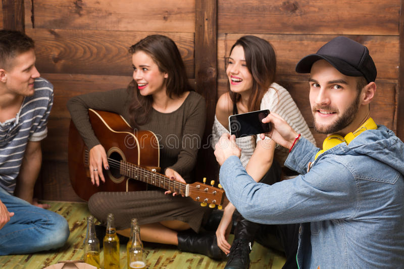 Happy friends spending their free time in good company stock photography