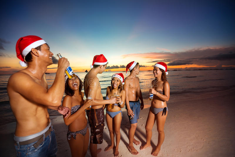 Happy friends on summer vacation toasting for Christmas stock photography