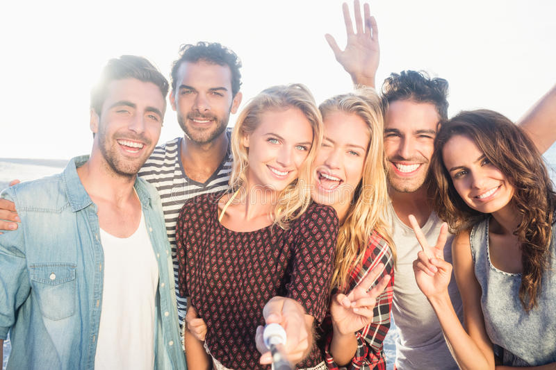 Happy friends taking selfie stock images