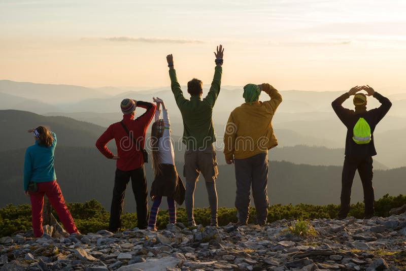 Happy friends during a travel in mountains stock photography
