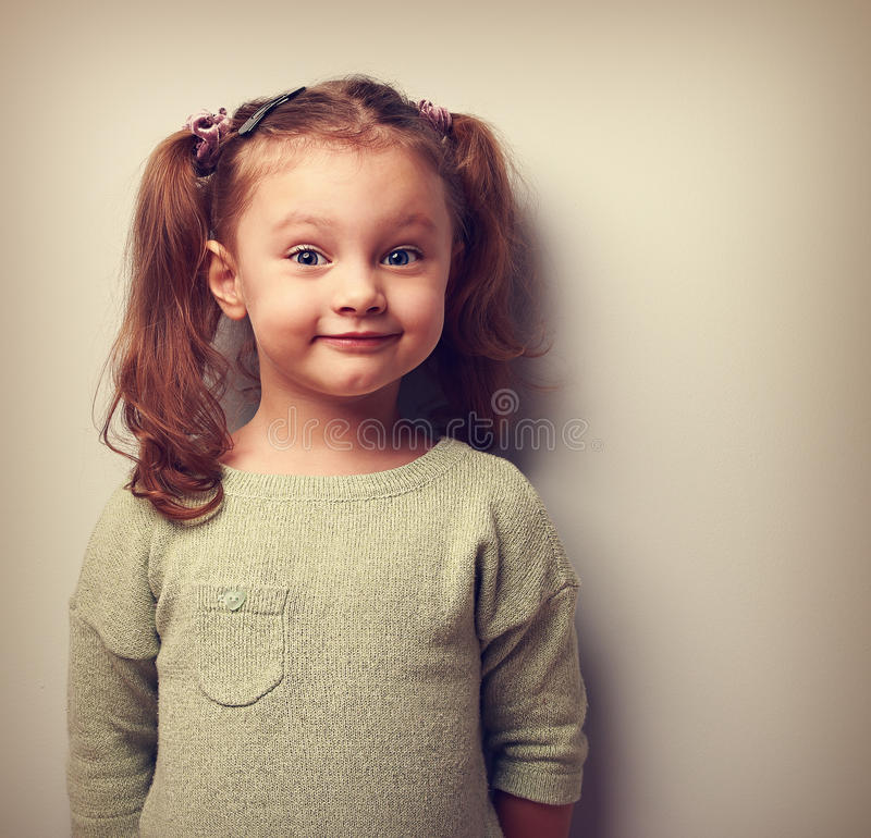 Happy fun girl looking with smile. Happiness in childhood stock photo