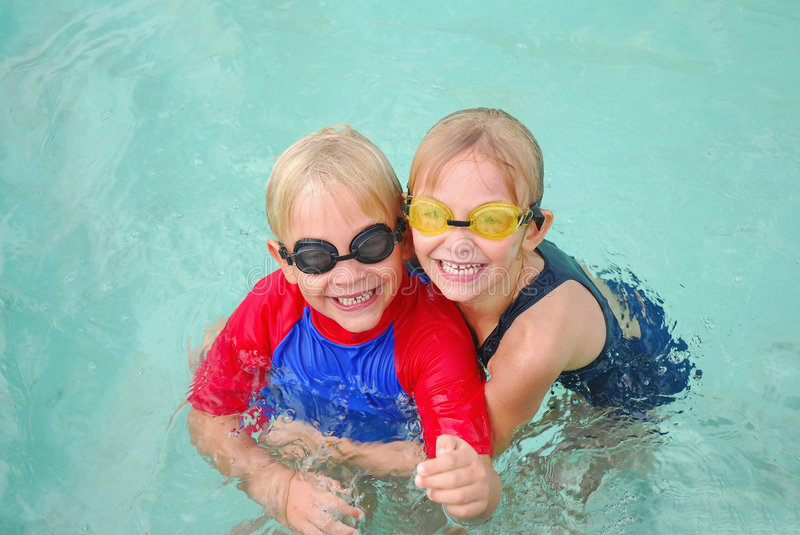 Happy fun kids. Outdoor children portrait of a cute little caucasian boy and girl child with goggles and costumes and happy smiling facial expression staring stock images