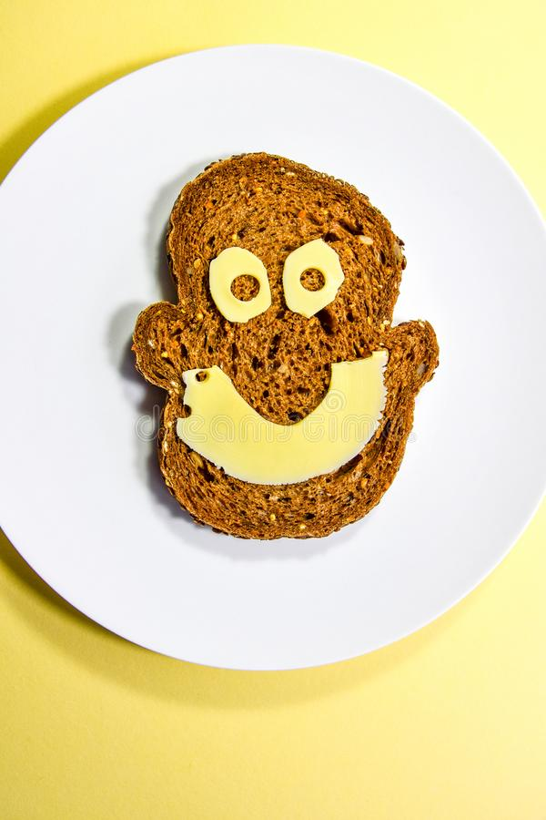 Happy healthy cheese sandwich with a smiley face stock photography