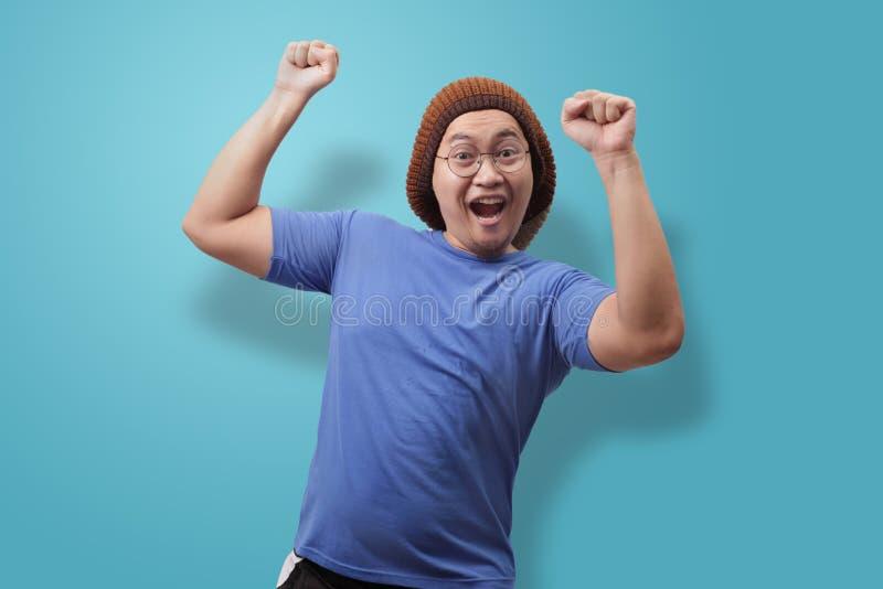 Happy Funny Asian Man Dancing Full of Joy stock images