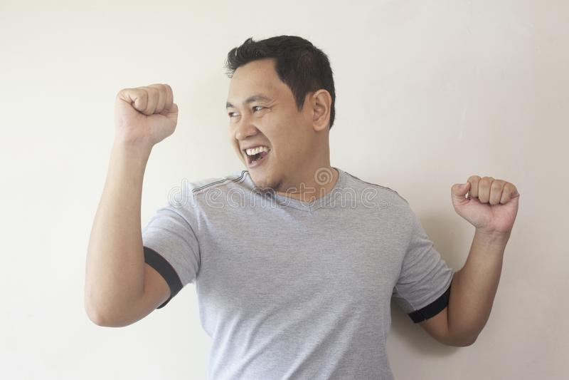 Happy Funny Asian Man Dancing Full of Joy stock image