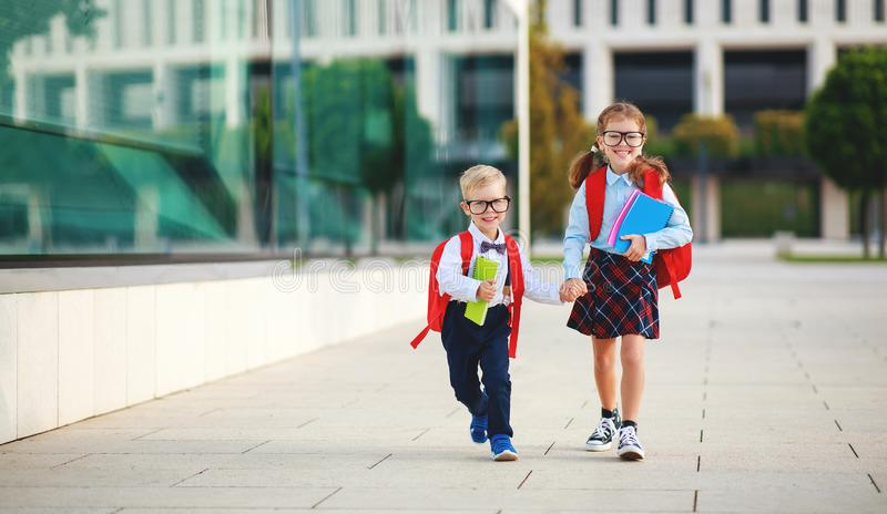 Happy  funny children    schoolgirl  and schoolboy student elementary school stock images
