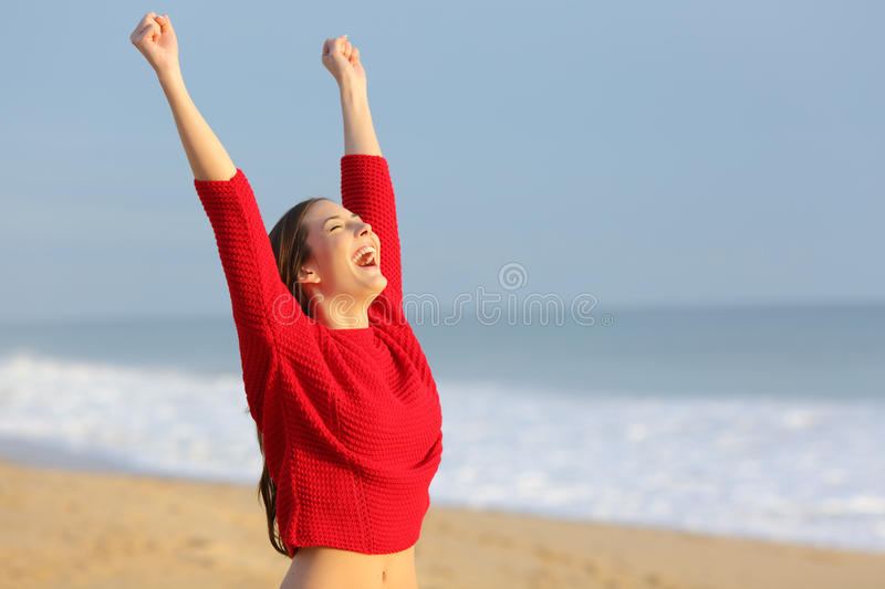 Happy funny excited woman on the beach stock photography