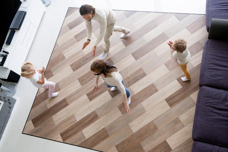 Happy family playing hide and seek at home stock photography