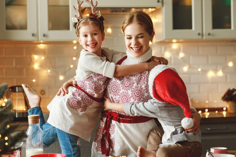 Happy family mother and children bake christmas cookies stock photography