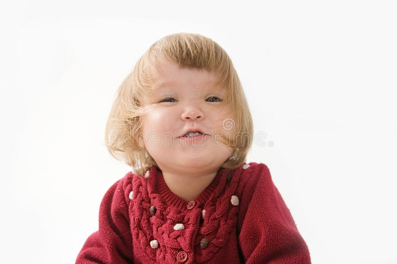 Happy funny little girl emotional playing. cute caucasian blond baby girl with bear and doll royalty free stock photography