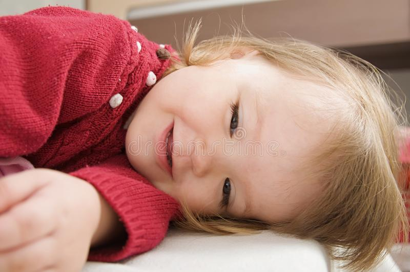 Happy funny little girl emotional playing. cute caucasian blond baby royalty free stock photos