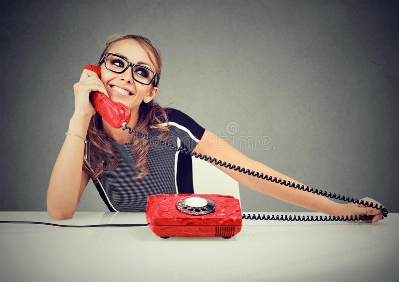 Happy funny looking young woman calling someone royalty free stock photography
