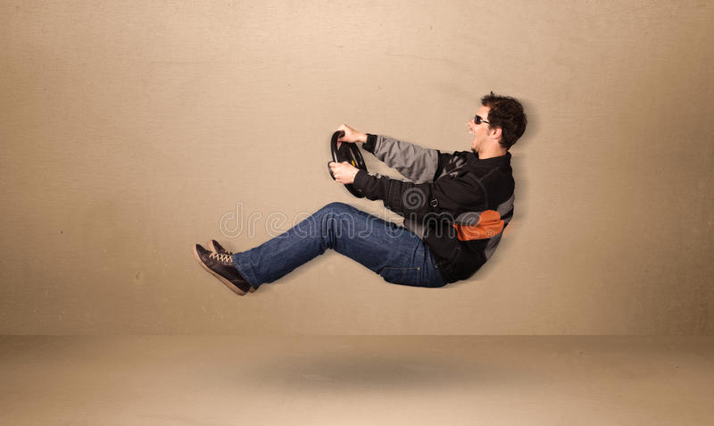 Happy funny man driving a flying car concept. On background royalty free stock image