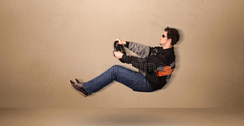 Happy funny man driving a flying car concept. On background royalty free stock photo