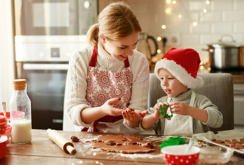 Happy family mother and child bake christmas cookies stock photography