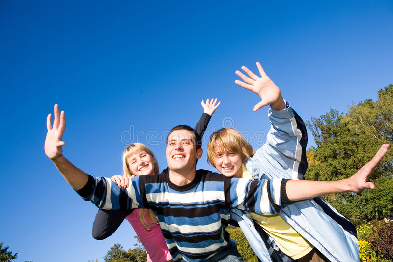 Happy funny people jumping. End flies in blue sky stock photo