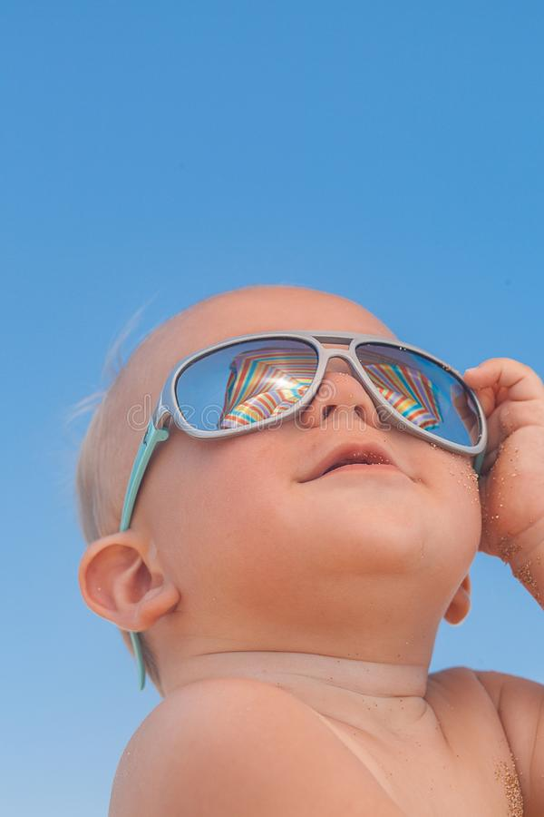 Happy funny smiling cute baby boy with sunglasses. Adorable Happy funny smiling cute baby boy with sunglasses on the beach stock photos