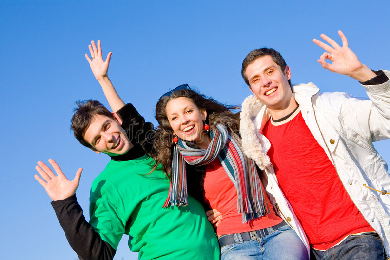 Happy funny team. Happy young funny team. blue sky royalty free stock photos