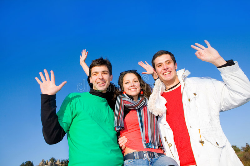 Happy funny team. Smiling under blue sky stock photo