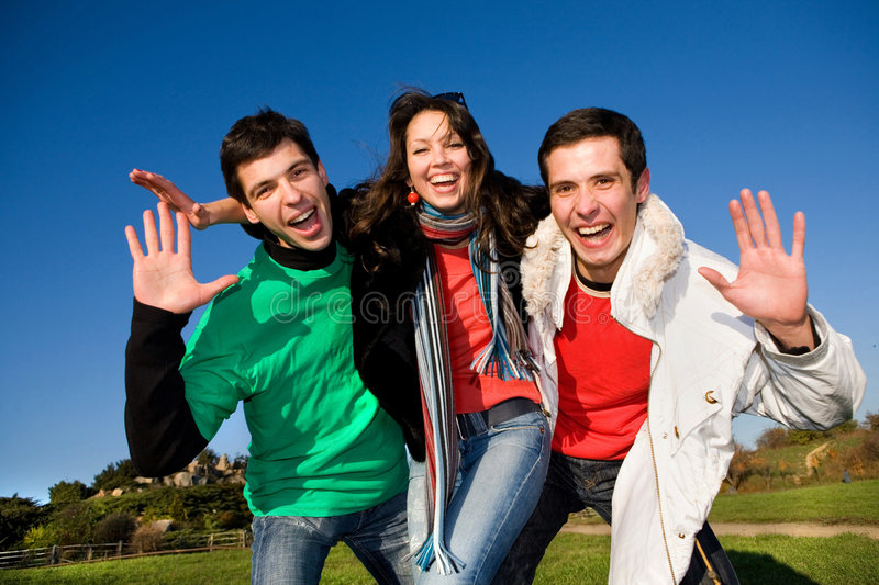 Happy funny team jumping. Friends royalty free stock photo