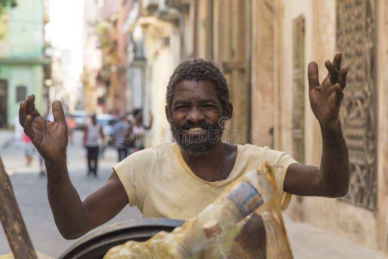 Happy garbage worker Havana. Happy cuban garbage worker in Old Havana (Spanish: Habana Vieja), Cuba. Citizens of Havana is called Habaneros in Spanish royalty free stock images