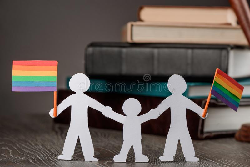 Happy gay couple with child stock image