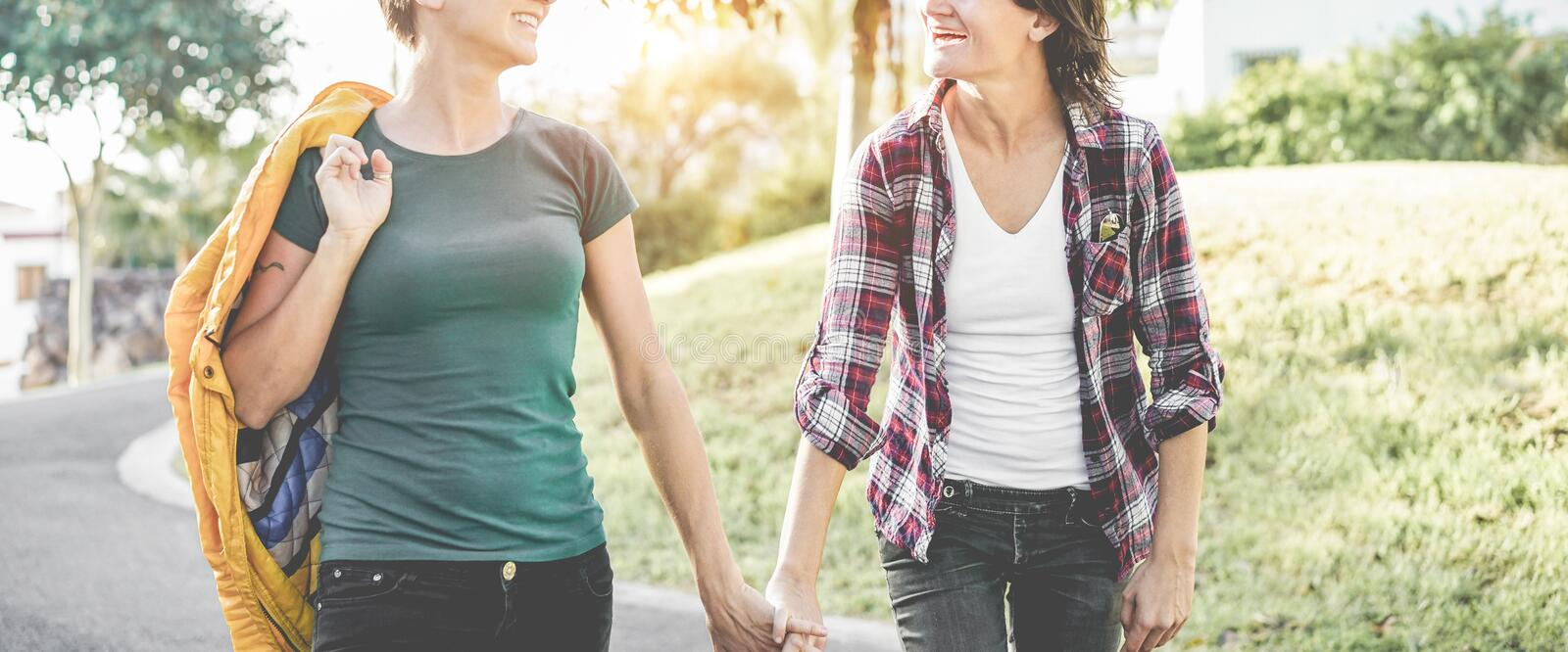Happy gay couple having fun together outdoor - Young women joking and playing together - Equality right, love, homosexuality royalty free stock photography
