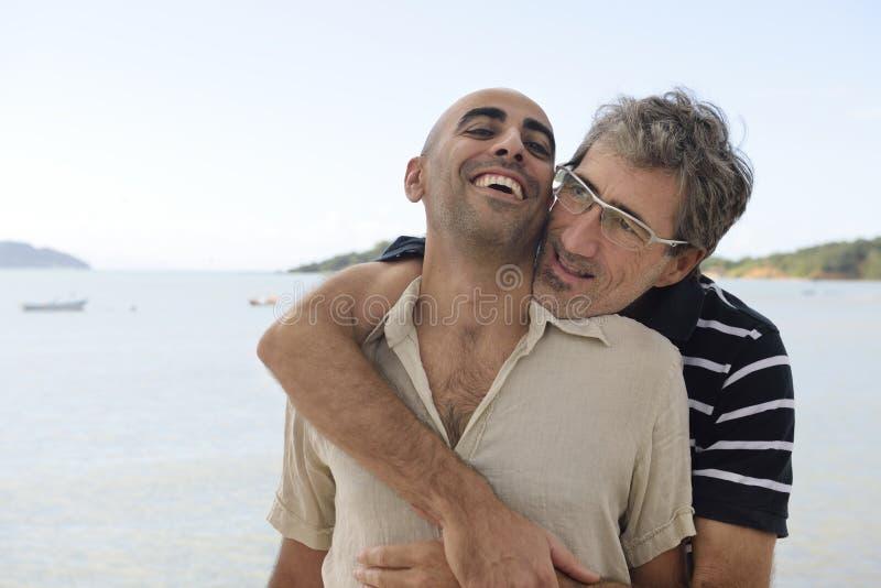 Happy gay couple on vacation royalty free stock photo