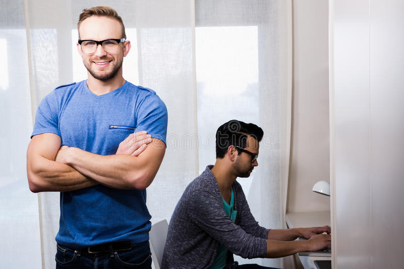 Happy gay couple working together. In office royalty free stock photo