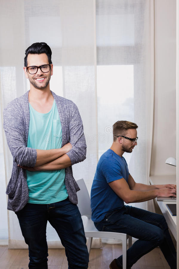 Happy gay couple working together. In office stock image