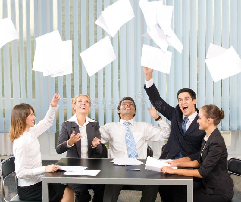 Happy gesturing business team stock photo