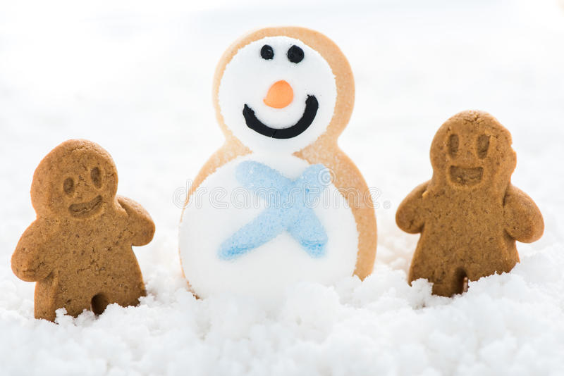 Happy gingerbread kids play on snow. Making snowman stock photography