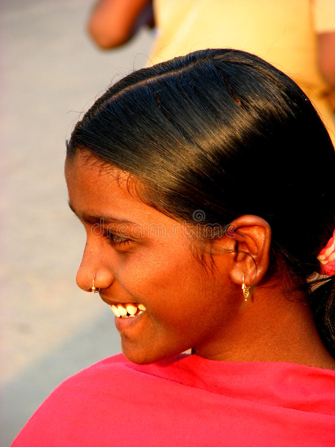 Happy Girl. A poor Indian girl smiles happily royalty free stock image