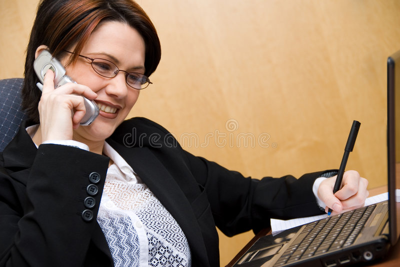 Happy girl. Happy cute woman on the phone in a meeting stock photo