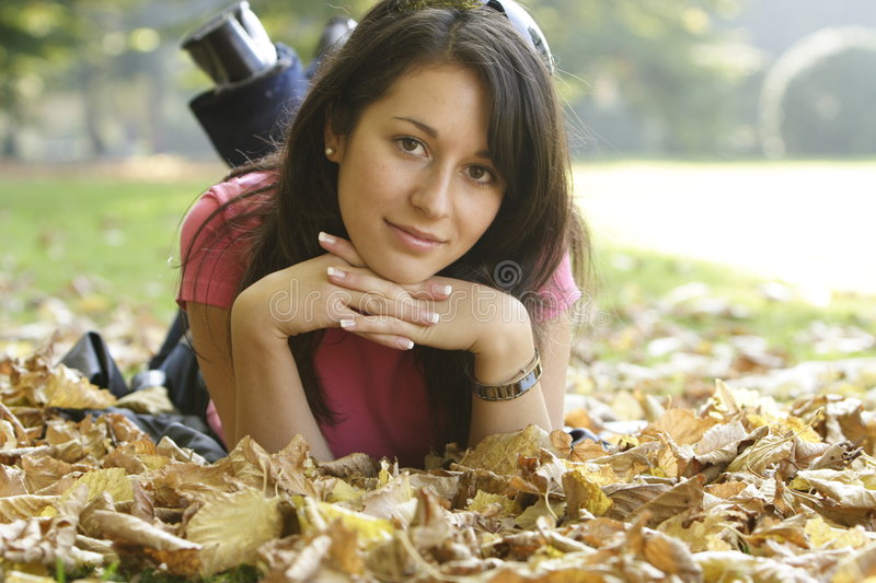 Happy girl. Girl relaxing in an autumn park stock photo